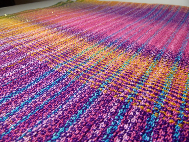 Colours of India baby wrap Fuchsia, Purple Passion and Dark Gold merc cotton weft, close-up 3