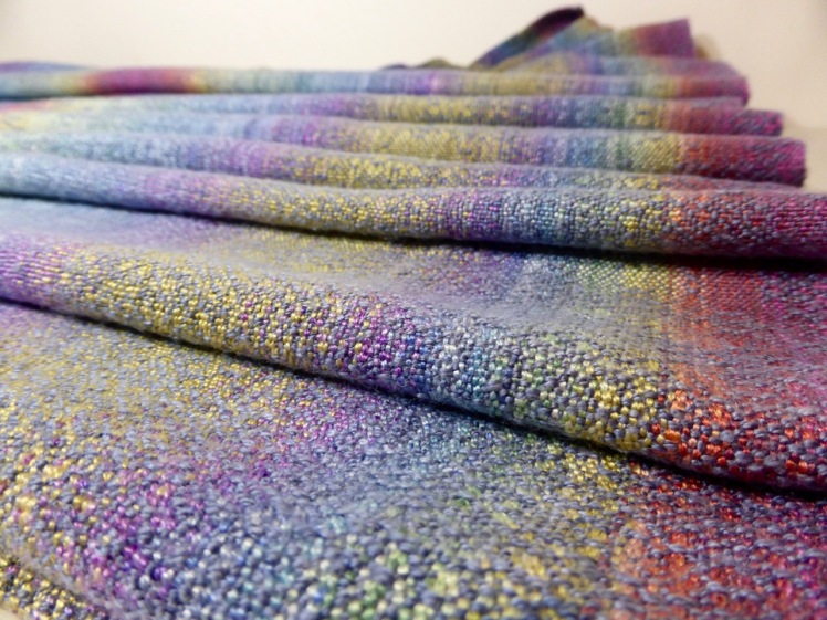 Rainbow End wrap, grey silk weft, crackle weave, across close-up